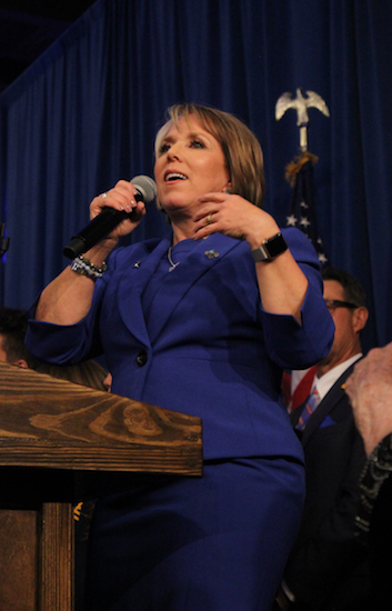 Michelle Lujan Grisham dances on stage to give her victory speech on Tuesday night at Hotel Albuquerque. Photo By Amy Byres/ NM News Port