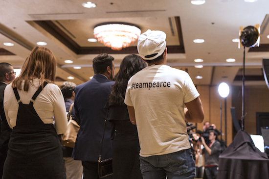 "A young man wearing a ""#teampearce"" watches as Republican Steve Pearce delivers his consession speech at the Republican Watch Party. Pearce lost to Democrat Michelle Lujan Grisham for the govenors seat. Photo by Anna Padilla/ NM News Port"