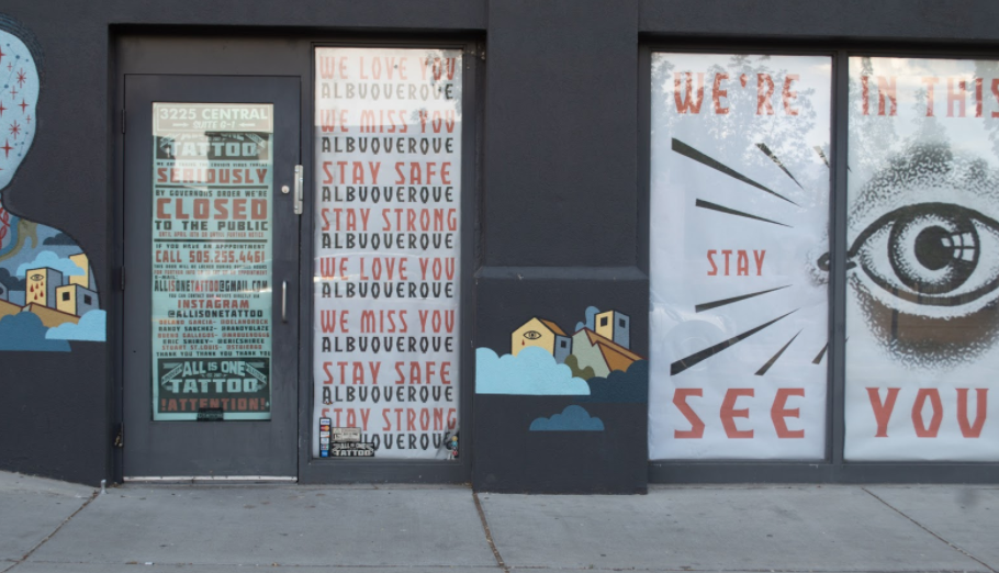"""storefront signage says """"we're all in this together"""""""