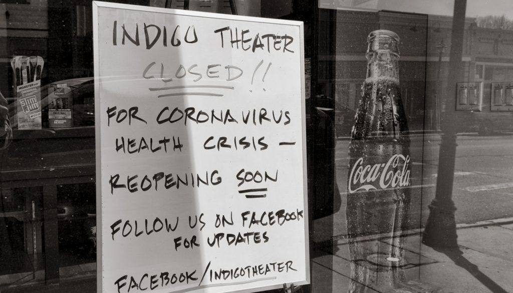 storefront window displays closure sign