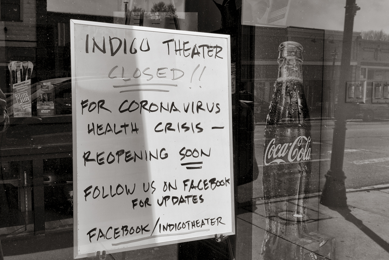 storefront window displays closure sign