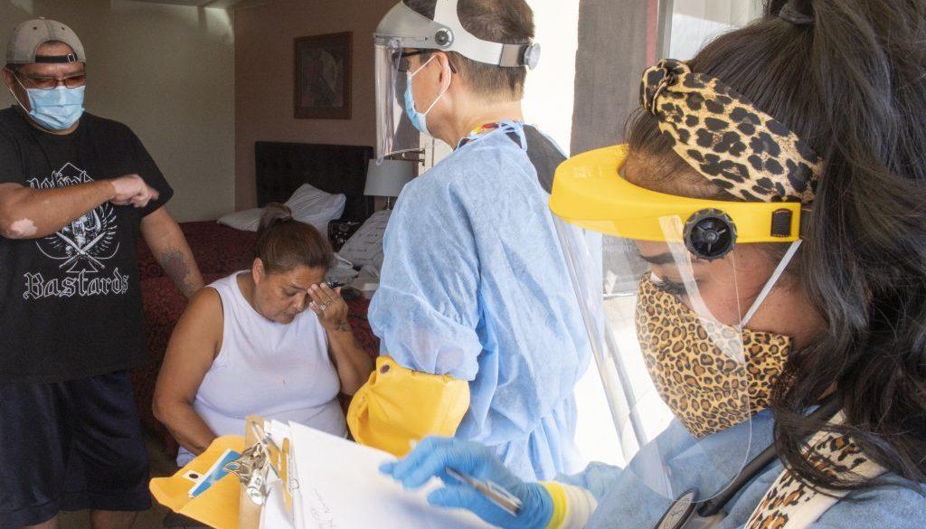 medics in masks enter motel room of pandemic patients