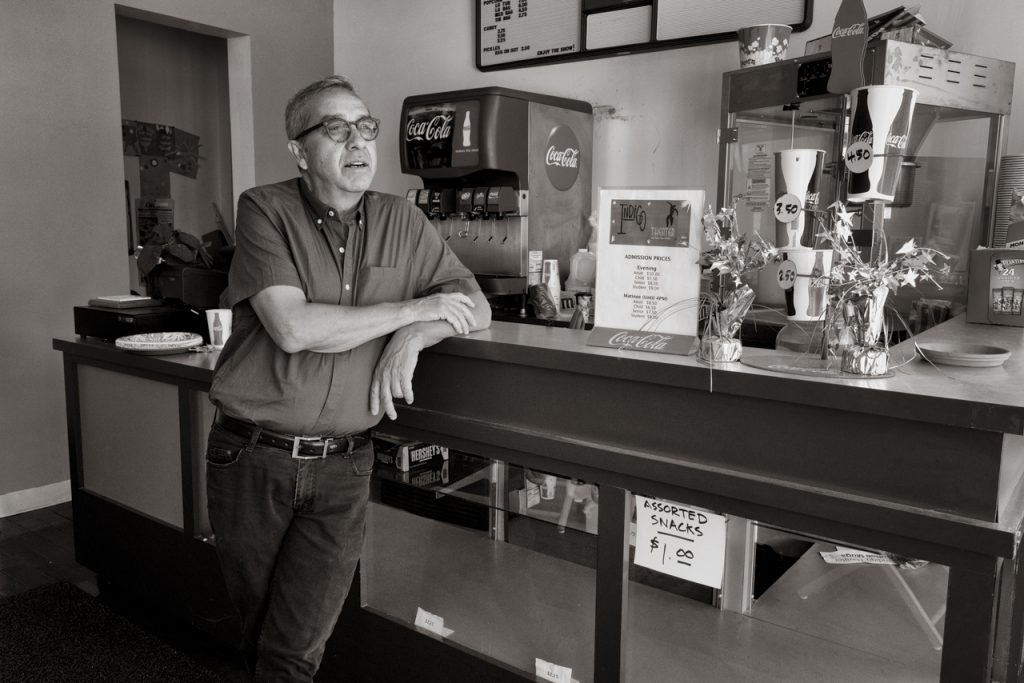 photo of man at concession stand in theater lobby
