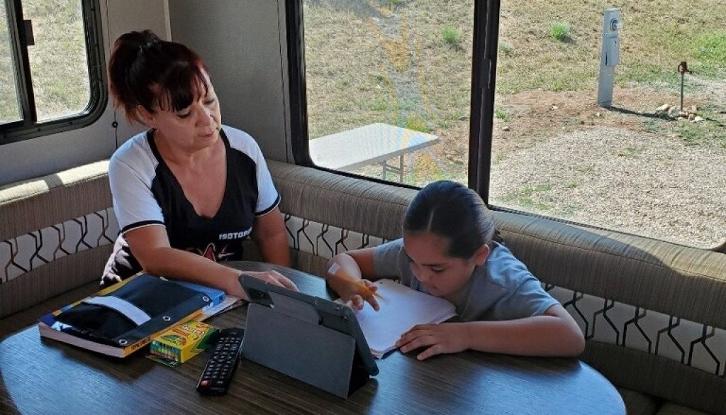 Angela Garcia helping Tara with her school work
